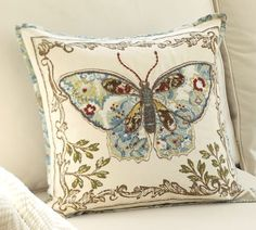 pottery barn's beautiful crewel/ applique pillows. This wouldn't be a fast project but it could be a DIY for any one who embroiders and sews.