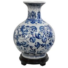 This handmade Chinese blue-and-white vase is the perfect elegant accent for any room. This lovely piece can be used to display flowers or simply displayed as it is. At 12' x 9', this vase is ideally sized for a tabletop or mantelpiece.
