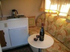 A small round table that can be put up by the front bench so that the dinette can stay down in a bed.