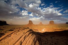 """MONUMENT VALLEY, UTAH – September 3, 2006: A sandstorm builds up behind the famous """"two mittens"""" in Monument Valley, Utah. Monument Valley is part of the Navajo Indian reservation. (photo by Ian Shive/Aurora)"""