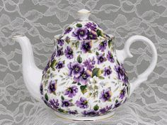Pansy Chintz Bone China Teapot---> Why hello there tea pot? I might just cave and buy you soon..just might.