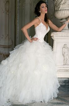 Ruffles and glitter on this #weddingdress with a corset bodice. For the #bride who wants a fairy-tail look for her #wedding