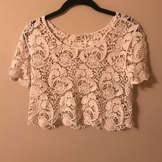 LACE CROP TOP never worn! cream lace crop top! Will combine with any purchase for only $5! Only lace- there is no additional fabric Forever 21 Tops Crop Tops