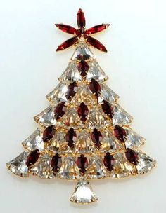 Dominique Bell Stone Christmas Tree Pin  Ca. 2007 Dominique tree with clear bell-shaped stones and red accents. Uncommonly not signed, but purchased directly from the designer in 2007. Dominique Christmas tree pins, while contemporary, are highly collectible. Each piece is made by hand in the U.S.A. using components and techniques found in quality vintage pieces.