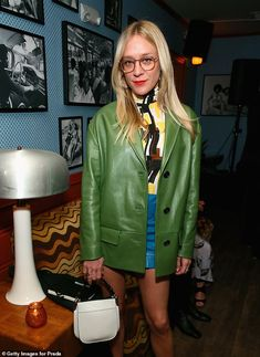 Beauty: Chloe looked gorgeous in a leather ensemble, featuring a green jacket and short bl...