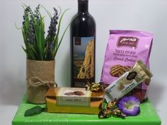 Make an impression with this charming Purim package. Arrangement contains Bottle of cabernet sauvignon wine Bag of caramel cookies Halva bar Gourmet hazelnut truffles Chocolate butter toffees Refreshing and naturally elegant lavender arrangement