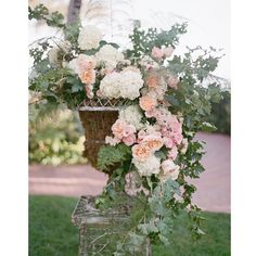 My prized antique urns filled with gorgeous hydrangea open garden roses and grapevine ( in it's prime)! @elizabethmessina via @angela4design