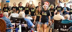 """Members of Our Lady of Grace theatre ministry, known at the Youth Theatre of  Northern Baltimore, perform numbers from """"Seussical"""" for patients at the Baltimore VA hospital."""