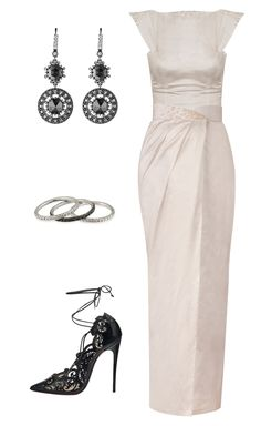 A sophisticated column silhouette with a glamorous touch of black diamonds and intricate pumps. black and white wedding