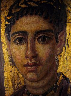 Fayum (or Fayoum) mummy portrait of a young woman with a gilded wreath by ggnyc, via Flickr