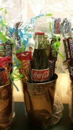 Baby shower favors for the guys. A small bottle or rum a bottle of crown popcorn, peanuts, candy bars and chips. The perfect prize for the males at a co-ed baby shower.