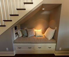 under stairs reading nook. Man my home is gonna be filled with reading nooks all… under stairs reading nook. Space Under Stairs, Under Staircase Ideas, Under Basement Stairs, Shelves Under Stairs, Basement Stairway, Closet Under Stairs, Under The Stairs Toilet, Cupboard Under The Stairs, Under Stairs Dog House
