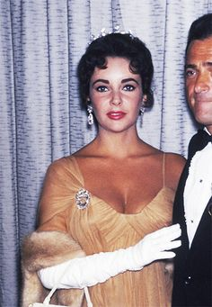 "Elizabeth Taylor with Mike Todd. See the tiara? Diamond Tiara, 1957. ""When [third husband Mike Todd] gave me this tiara, he said, 'You're my queen, and I think you should have a tiara,'"" Taylor wrote in A Life in Jewelry. ""I wore it for the first time when we went to the Academy Awards. It was the most perfect night, because Mike's film won an Oscar. It wasn't fashionable to wear tiaras then, but I wore it anyway, because he was my king."" Taylor in the tiara at the 1957 Cannes Film Festival."