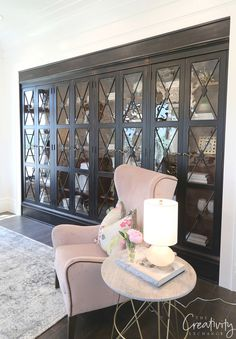 Black built in cabinetry with glass doors.