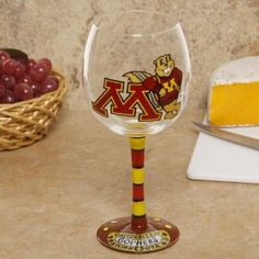 NCAA Minnesota Golden Gophers Hand-Painted 16oz. Wine Glass by Football Fanatics. $22.25. Minnesota Golden Gophers Hand-Painted 16oz. Wine GlassHand-paintedReady to wrapOfficially licensed collegiate productTeam logo and colorsHolds approximately 16 ouncesPre-packaged caseHand-paintedHolds approximately 16 ouncesTeam logo and colorsPre-packaged caseReady to wrapOfficially licensed collegiate product