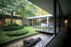 Marcel Breuer's Hooper House II in Baltimore, Maryland. Fflagstones used in the walls. Bauhaus geometry. The interior courtyard and view out to the landscape create a nice sense of intimacy while keeping the house in touch with its surroundings. Photo by Raymond Meier.