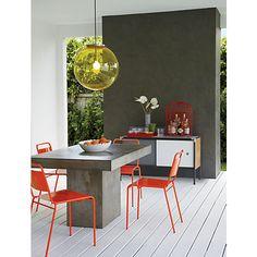 Mesa jantar de ardósia com jogo de cadeiras vermelhas