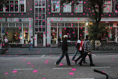 LET'S STICK TOGETHER by studio VOLLAERSZWART. A visual virus of 50.000 fluorescent stickers infected the street, pavement, windows and buildings during De Wereld van Witte de With art festival.