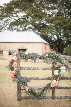 U N D E R T H E M I S T L E T O E : Uhh, not quite, but for an outdoor wedding (or even indoor behind the bridal table!) this gorgeous arrangement can't be beat!