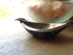 i obsess...vintage brass ashtray with turquoise inlaid sides.  honeywell home yum