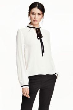 30€ jun16 Blusa con lazada | H&M