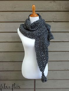 The Early Morning Wrap is an elegant wrap that takes the chill away. Bulky yarn and and an easy to crochet stitch make a cozy wrap full of texture! Add the optional tassels for a pretty added extra too.