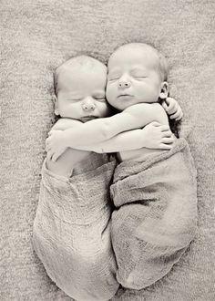 Newborn twins pose....I miss the days of innocence