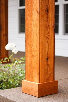 Cedar Pillars to our Dream House We turned the plain white front porch pillars into cedar pillars, and our porch has never looked better.We turned the plain white front porch pillars into cedar pillars, and our porch has never looked better. Front Porch Pillars, Front Porch Posts, House Pillars, Wood Columns Porch, Rustic Front Porches, How To Build Porch Columns, Front Porch Deck, Front Porch Design, Porch Designs