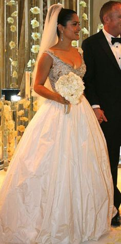 Look of the Day › December 29, 2009 BEST OF 2009: MOST BEAUTIFUL BRIDES Hayek had a lavishly embellished gown custom-made by Balenciaga designer Nicholas Ghesquiere WHERE In Venice, Italy for her April 25th wedding to businessman Francois-Henri Pinault