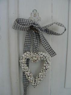 Cute idea for a wreath: hang using gingham ribbon.