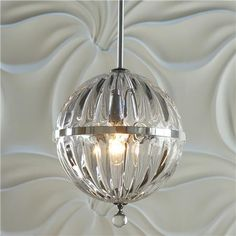 Fluted Glass Globe Pendant (similar to the pricey pricey Restoration Hardware - if you squint really hard - but about two thousand dollars cheaper at $289.) Don't love it though...