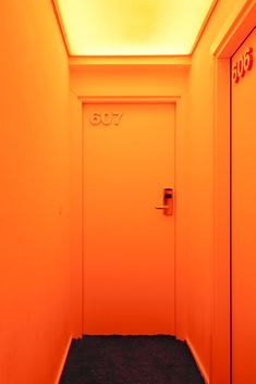 Pantone Hotel, Brussels - love the numbers on the doors with everything painted the same color.