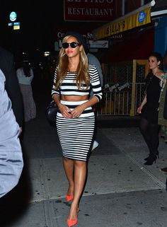 Beyonce rocks a crop top leaving Kanye West's birthday party in NYC.