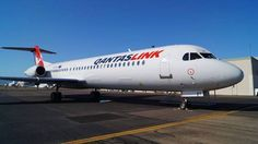 QantasLink Fokker 100 (F-28-0100) VH-NHY after emerging from the Flying Colours Aviation paint shop at Townsville-International, 30th July 2015. This is the first of 14 Network Aviation Fokker 100 aircraft that will all eventually be rebranded in QantasLink colours and continue operating domestic routes in Western Australia. (Image: Qantas Group)