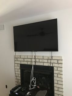 image of tv hung on wall with a wiring mess house wiring, wire, tv
