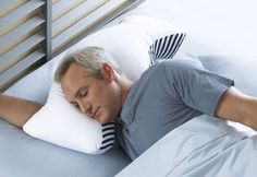 Anti-Snore Pillow from Sharperimage.com $59.99 **Yeah, if this works it would be worth it...**