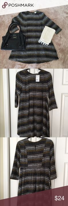 🔵Just Listed🔵 H&M NWT dress sz 8 Long sleeved A-line dress with gold, black & white print all over in size 8. Perfect to wear with boots for fall! Has keyhole & button closure in back. 100% viscose. Never worn, still new with tags. Comes from smoke & pet free home. H&M Dresses