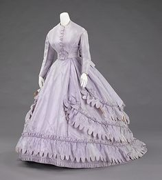 Evening ensemble Design House: Worth and Bobergh Designer: Charles Frederick Worth (French (born England), Bourne 1825–1895 Paris) Date: 1862–65 Culture: French Medium: silk Dimensions: Length at CB (a): 25 1/2 in. (64.8 cm) Length at CB (b): 18 in. (45.7 cm) Length at CB (c): 58 in. (147.3 cm) Other (d): 35 in. (88.9 cm) Credit Line: Brooklyn Museum Costume Collection at The Metropolitan Museum of Art, Gift of the Brooklyn Museum, 2009; Designated Purchase Fund, 1987 Accession Number…