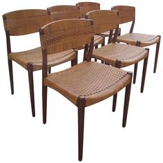 Six Solid Teak and Caned Chairs | From a unique collection of antique and modern dining room chairs at http://www.1stdibs.com/furniture/seating/dining-room-chairs/