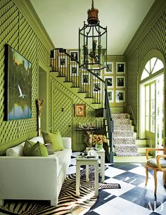 At Peter Rogers's New Orleans home, oversize black-and-white tiles add a crisp, clean element to the apple-green surround, derived from one of his favorite fabrics.