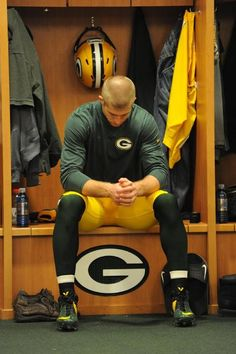 jordy nelson...coolest guy ever. he grew up on a farm and he is a Christian.