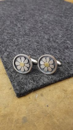 Framed Daisy cufflinks by Diana Greenwood                                                                                                                                                     More