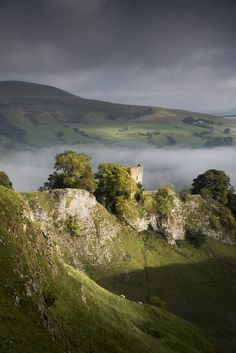 Peveril Castle is a ruined early medieval castle overlooking the village of Castleton in the English county of Derbyshire.