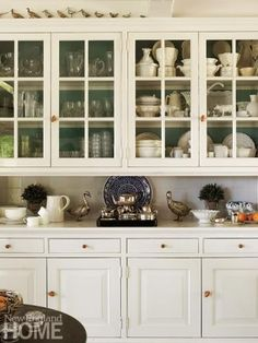 The kitchen cabinets were custom built on site by Dutch cabinetmakers. Dutch Kitchen, Kitchen Cabinet Design, Kitchen Cabinets, Kitchen Designs, Kitchen Ideas, Living Room Shelves, Kitchen Family Rooms, New England Homes, Elements Of Style