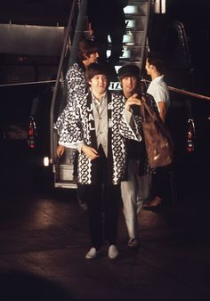 The Beatles arriving on a Japan Airlines DC-8-55 for a five-concert event in Tokyo on June 29, 1966