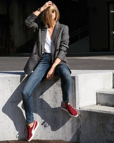 white top, jeans, grey blazer, burgundy sneakers