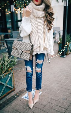 layer chunky knits, ripped jeans, and heels