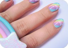 Adorable pastel rainbow and star nails