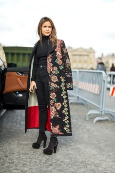 All black with a long floral Valentino coat.