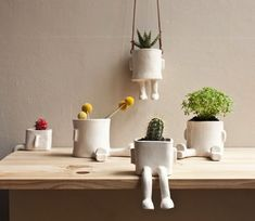 Handmade pots, designed and created to brighten the corners or areas of your home that need a touch of humor.